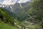 Mountain road descending into French village, Spanish/ French border. Ordesa Park,Pyreneese mountains, Spain.