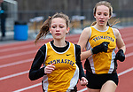 THOMASTON,  CT-040919JS07- Thomaston's Maegan Desmarais, left, and Kiersten Sundell, right, took first and second in the 1600 meter run during their Berkshire League meet with Housatonic Tuesday at Nystrom's Sports Complex in Thomaston.<br /> Jim Shannon Republican American