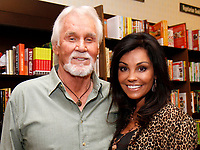 """20 March 2020 - Kenny Rogers, whose legendary music career spanned nearly six decades, has died at the age of 81. Rogers was inducted to the Country Music Hall of Fame in 2013."""" He had 24 No. 1 hits and through his career more than 50 million albums sold in the US alone. He was a six-time Country Music Awards winner and three-time Grammy Award winner. Some of his hits included """"Lady,"""" """"Lucille,"""" """"We've Got Tonight,"""" """"Islands In The Stream,"""" and """"Through the Years."""" His 1978 song """"The Gambler"""" inspired multiple TV movies, with Rogers as the main character. File Photo: October 7. 2012 - Alpharetta, GA - Kenny Rogers made a stop at the Barnes & Noble bookstore in Alpharetta, GA, where he met with fans who purchased his new autobiography, """"Luck Or Something Like It"""". Photo credit: Dan Harr/AdMedia"""