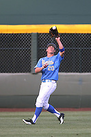 Jeff Gelalich #20 of the UCLA Bruins catches a fly ball during a game against the Oregon Ducks at Jackie Robinson Stadium on April 6, 2012 in Los Angeles,California. Oregon defeated UCLA 8-3.(Larry Goren/Four Seam Images)