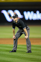 Umpire Justin Houser handles the calls on the bases during the Carolina League game between the Frederick Keys and the Winston-Salem Dash at BB&T Ballpark on May 24, 2016 in Winston-Salem, North Carolina.  The Keys defeated the Dash 7-1.  (Brian Westerholt/Four Seam Images)