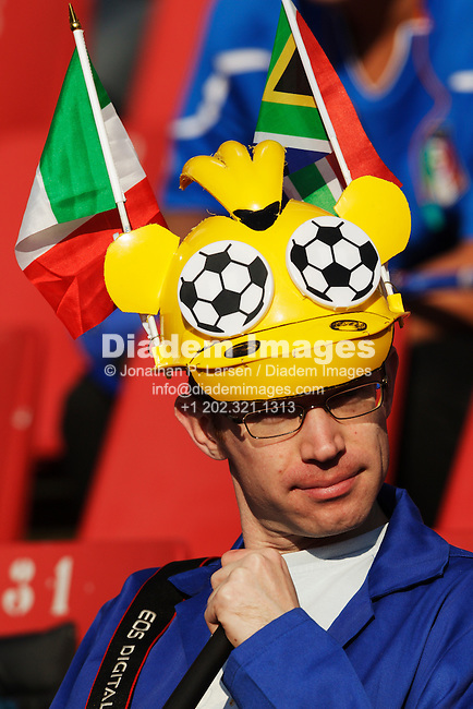 JOHANNESBURG, SOUTH AFRICA - JUNE 24:  A spectator wears a lekarapa colorfully decorated with flags and soccer balls at the FIFA World Cup Group F match between Italy and Slovakia at Ellis Park Stadium on June 24, 2010 in Johannesburg, South Africa.  Editorial use only.  Commercial use prohibited.  No push to mobile device usage.  (Photograph by Jonathan Paul Larsen)