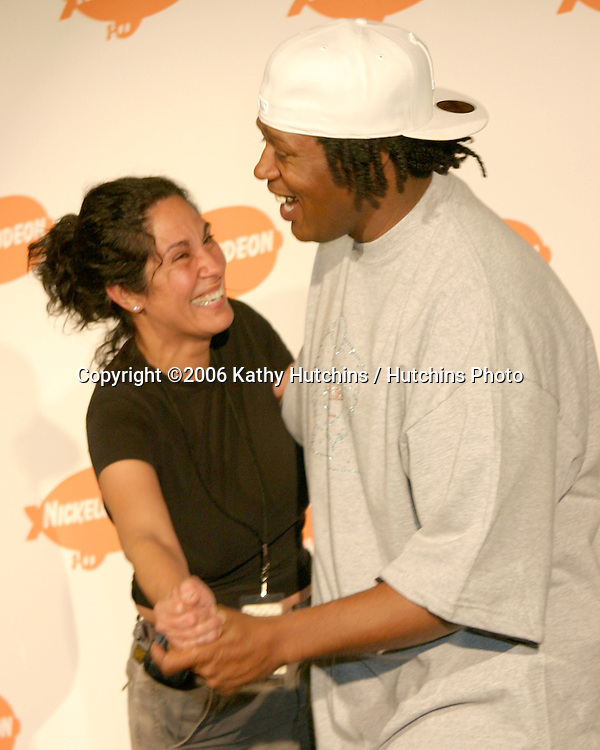 Photographer Lisa Rose dancing with MasterP in the press room at the .Nickelodeon Kid's Choice Awards.Pauley Pavillion, UCLA.Westwood, CA.April 1, 2006.©2006 Kathy Hutchins / Hutchins Photo....