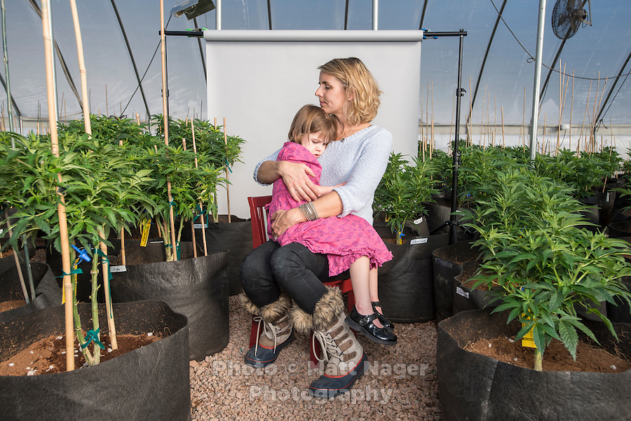 Charlotte Figi (cq, age 7) with her mom Paige Figi (cq) at the farm the grows the Charlotte's Web strain of marijuana in Colorado Springs, Colorado, Thursday, February 6, 2013. Charlotte suffered from over 100 seizure like symptoms and epilepsy before discovering a strain of marijuana that would stop her seizures. <br /> <br /> Photo by Matt Nager