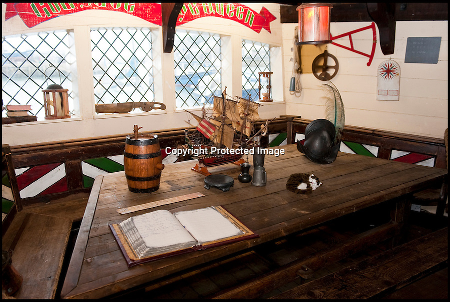 BNPS.co.uk (01202 558833)<br /> Pic: PhilYeomans/BNPS<br /> <br /> Captains cabin.<br /> <br /> Yours for £360k - Full size replica of Sir Francis Drake's legendary ship the Golden Hind.<br /> <br /> Sir Francis Drake's famed Elizabethan galleon, in which he circumnavigated the globe, is a floating museum in Brixham harbour in Devon.<br /> <br /> The 120ft wooden ship is an exact remake of the flagship which Drake sailed round the world from 1577 to 1580, the first Englishman ever to circumnavigate the globe.<br /> <br /> The boat, which was built in 1988, is the second of two replica Golden Hinds which have taken pride of place in Brixham, Devon, since the 1954.<br /> <br /> The current owner, Simon Read, inherited the boat from his father John who bought the original replica in 1970 and ran it until 1988 when it was replaced by a new version.<br /> <br /> Above decks it boasts two square-rigged masts each with iconic 'crow's nests', and six canons.
