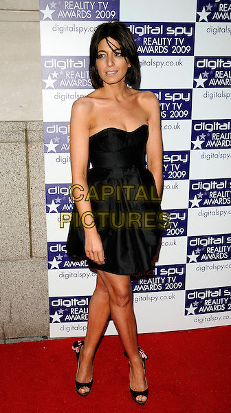 CLAUDIA WINKLEMAN.The Digital Spy Reality TV Awards at the Bloomsbury Ballroom, London, England. .April 6th, 2009 .full length black dress strapless open toe shoes .CAP/CAN.©Can Nguyen/Capital Pictures.