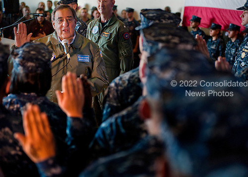 United States Secretary of Defense Leon E. Panetta re-enlists 21 Sailors Saturday, January 21, 2012 aboard the aircraft carrier USS Enterprise (CVN 65). The Enterprise Carrier Strike Group is underway conducting a composite training unit exercise (COMPTUEX). .Mandatory Credit: Scott Pittman / U.S. Navy via CNP