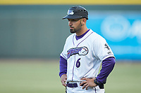 Winston-Salem Dash coach Anthony Santiago (6) coaches first base during the game against the Wilmington Blue Rocks at BB&T Ballpark on April 16, 2019 in Winston-Salem, North Carolina. The Blue Rocks defeated the Dash 4-3. (Brian Westerholt/Four Seam Images)