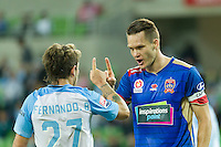 Melbourne, 10 November 2016 - FERNANDO BRANDAN (27) of Melbourne City and NIGEL BOOGAARD (4) of the Jets exchange words in the round 6 match of the A-League between Melbourne City and Newcastle Jets at AAMI Park, Melbourne, Australia. Melbourne won 2-1 (Photo Sydney Low / sydlow.com)