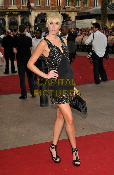 "KIMBERLY STEWART .Red Carpet Arrivals at the ""Sex And The City"" Movie World Premiere, Odeon Leicester Square, London, England, UK,.May 12th 2008..full length black silver studded dress hand on hip shoes sandals .CAP/PL.©Phil Loftus/Capital Pictures"