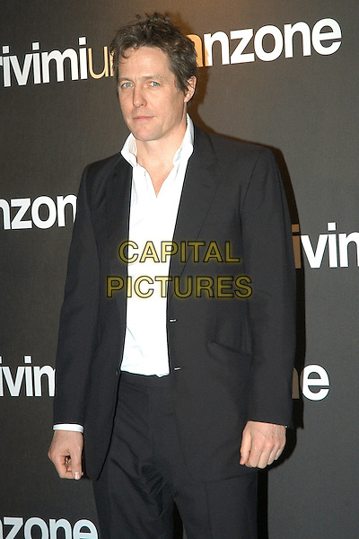 "HUGH GRANT.At the premiere of ""Music and Lyrics"" at the Warner Village Cinema, Rome, Italy..February 21st, 2007.half length black suit jacket.CAP/CAV.©Luca Cavallari/Capital Pictures"