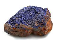 Drusy azurite crystals encrusting a rock. Azurite is a deep blue copper carbonate hydroxide mineral. Copper Queen Mine, Bisbee, Arizona, USA