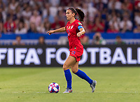 LYON,  - JULY 2: Alex Morgan #13 dribbles during a game between England and USWNT at Stade de Lyon on July 2, 2019 in Lyon, France.