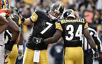PITTSBURGH, PA - DECEMBER 04:  Rashard Mendenhall #34 of the Pittsburgh Steelers is congratulated by teammate Ben Roethlisberger #7 after scoring a touchdown in the first half against the Cincinnati Bengals during the game on December 4, 2011 at Heinz Field in Pittsburgh, Pennsylvania.  (Photo by Jared Wickerham/Getty Images)