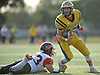 Jason Seiter #23, Bethpage quarterback, right, scrambles for a gain as Dion Kuinlan #33 of Plainedge looks to grab his foot for a tackle during a Nassau County Conference III varsity football game at Bethpage High School on Saturday, Oct. 21, 2017. Bethpage won by a score of 28-21.