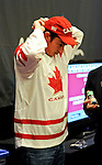 "Tom ""Durr"" Dwan dons Canada gear after losing a prop bet."