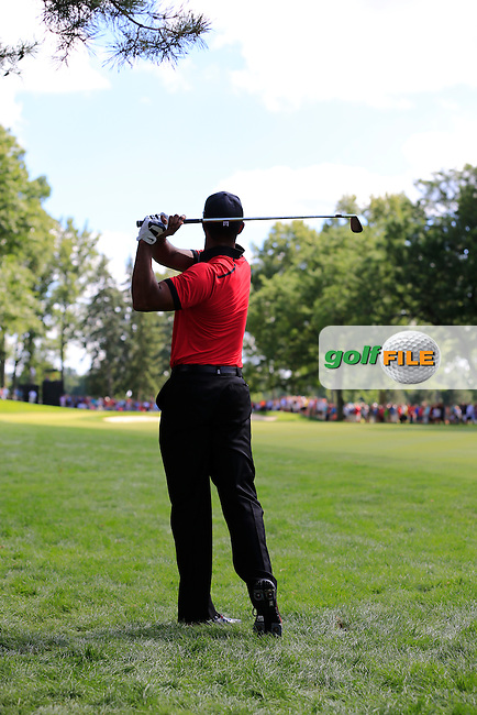 Tiger Woods (USA) plays his 2nd shot from the rough on the 11th hole during Sunday's Final Round of the 2013 Bridgestone Invitational WGC tournament held at the Firestone Country Club, Akron, Ohio. 4th August 2013.<br /> Picture: Eoin Clarke www.golffile.ie