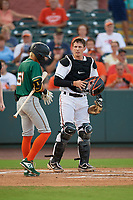 Delmarva Shorebirds catcher Adley Rutschman (37) talks with Greensboro Grasshoppers Ji-Hwan Bae (51) before an at bat during a South Atlantic League game on August 21, 2019 at Arthur W. Perdue Stadium in Salisbury, Maryland.  Delmarva defeated Greensboro 1-0.  (Mike Janes/Four Seam Images)