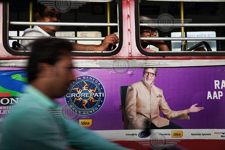 An advertisement on a bus features Amitabh Bachchan..