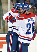 Terrence Wallin (UML - 9), Jake Suter (UML - 28) - The University of Massachusetts Lowell River Hawks defeated the visiting American International College Yellow Jackets 6-1 on Tuesday, December 3, 2013, at Tsongas Arena in Lowell, Massachusetts.