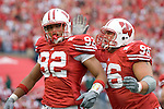 MADISON, WI - SEPTEMBER 9: Nick Hayden #96 and Matthew Shaughnessy #92 of the Wisconsin Badgers celebrate a defensive play against against the Western Illinois Leathernecks at Camp Randall Stadium on September 9, 2006 in Madison, Wisconsin. The Badgers beat the Leathernecks 34-10. (Photo by David Stluka)