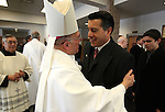 Bishop of Las Vegas Joseph A. Pepe hugs Nevada Gov.-elect Brian Sandoval following Mass at St. Teresa of Avila Catholic Church in Carson City, Nev., on Monday, Jan. 3, 2011. The Sandoval family attended a special mass before the inauguation. Bishop Gonzalo Castellanos, with St. Thomas Aquinas Cathedral in Reno, is at left and James Sandoval, 15, is at right. <br /> Photo by Cathleen Allison