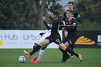 Jack-Henry Sinclair tries to tackle Raynick Laeta during the 2019 OFC Champions League quarter final football match between Team Wellington and Henderson Eels at David Farrington Park in Wellington on Sunday, 7 April 2019. Photo: Dave Lintott / lintottphoto.co.nz