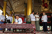 United States President Barack Obama signs a guest book during a tour of the Shwedagon Pagoda in Rangoon, Burma, November 19, 2012. .Mandatory Credit: Pete Souza - White House via CNP