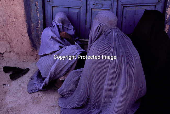 Three unidentified Afghan women sitting outside a house July 15, 1996 in central Herat, in the western part of Afghanistan. Women's rights has been taken back to the middle ages due to the policies of the Taliban regime. The Taliban took control of most of the country in 1996..(Photo: Per-Anders Pettersson/Liaison Agency)