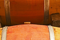 Two oak barrels, one with a silicone bung hole stopper  Chateau Bouscaut Cru Classe Cadaujac  Graves Pessac Leognan  Bordeaux Gironde Aquitaine France