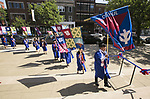 Students carrying the individual college flags make their way into the Saint Vincent de Paul Parish Church on DePaul University's Lincoln Park Campus for the annual Baccalaureate Mass Friday, June 9, 2017. The event was part of the 119th commencement ceremonies for the Chicago university. (DePaul University/Jamie Moncrief)