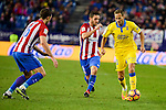 Atletico de Madrid Sime Vrsaljko and Koke Resurrección and UD Las Palmas Dani Castellano during La Liga match between Atletico de Madrid and UD Las Palmas at Vicente Calderon Stadium in Madrid, Spain. December 17, 2016. (ALTERPHOTOS/BorjaB.Hojas)