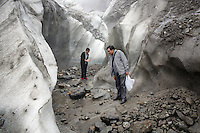 Tourists inside the lower reaches of the Hailuogou glacier in western Sichuan Province, China. As a result of rising temperatures on the Tibetan Plateau, the Hailuogou glacier has retreated over 2 km during the 20th century alone. Since the Little Ice Age, studies have revealed that the total monsoonal glacier coverage in the southeast of the Tibetan Plateau has decreased by as much as 30 percent, causing alarm in scientific circles.