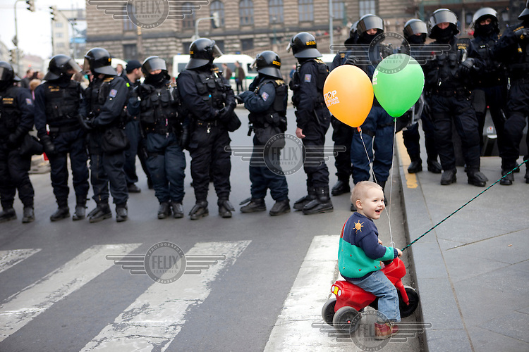 A child with balloons in Wenceslav Square in front of Czech special forces police during a demonstration against the planned US military radar base in Czech Republic, held on the day of Barack Obama's participation in the EU-US summit in Prague.