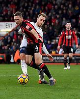 Tottenham Hotspur's Christian Eriksen (right) battles for possession with Bournemouth's Dan Gosling (left) <br /> <br /> Bournemouth 1 - 4 Tottenham Hotspur<br /> <br /> Photographer David Horton/CameraSport<br /> <br /> The Premier League - Bournemouth v Tottenham Hotspur - Sunday 11th March 2018 - Vitality Stadium - Bournemouth<br /> <br /> World Copyright &copy; 2018 CameraSport. All rights reserved. 43 Linden Ave. Countesthorpe. Leicester. England. LE8 5PG - Tel: +44 (0) 116 277 4147 - admin@camerasport.com - www.camerasport.com