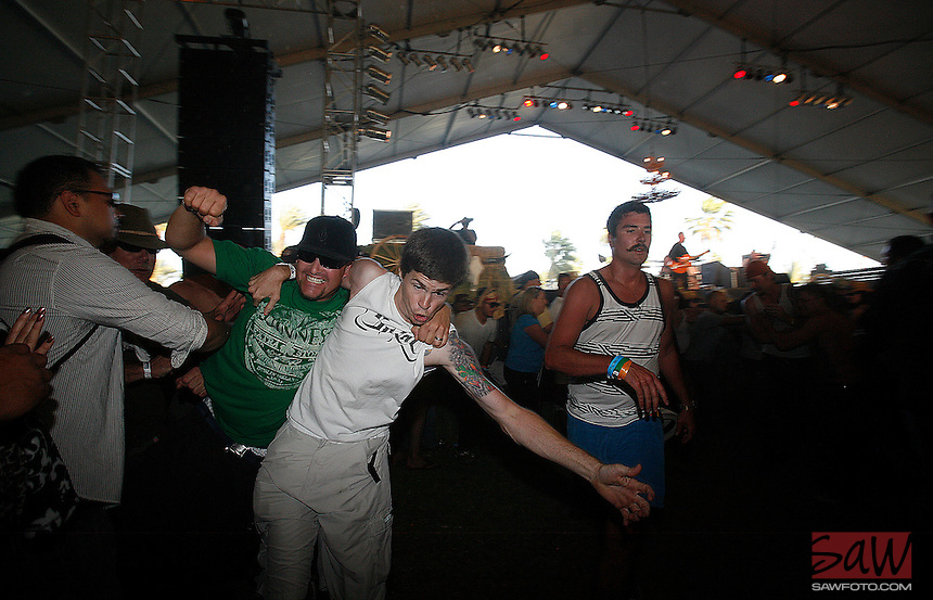 COACHELLA,CA - APRIL 25,2009: A moss pit forms in the audience during the Reverend Horton Heat performance at Stagecoach country music festival in Indio April 25, 2009.
