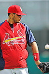 8 March 2012: St. Louis Cardinals' catcher Yadier Molina warms up prior to a Spring Training game against the Boston Red Sox at Roger Dean Stadium in Jupiter, Florida. The Cardinals defeated the Red Sox 9-3 in Grapefruit League action. Mandatory Credit: Ed Wolfstein Photo