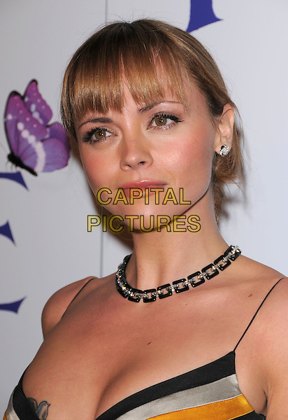 CHRISTINA RICCI.The L.A. Premiere of Penelope held at The DGA in West Hollywood, California, USA..February 20th, 2008                                                                     .headshot portrait fringe bangs tattoo necklace.CAP/DVS.©Debbie VanStory/Capital Pictures.
