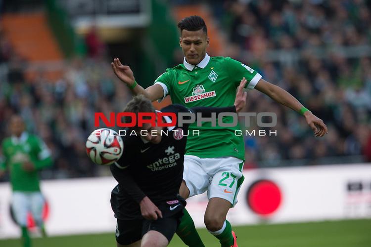 04.04.2015, Weser Stadion, Bremen, GER, 1.FBL. Werder Bremen vs 1. FSV Mainz 05, im Bild<br /> <br /> Niko Bungert (FSV Mainz 05 #26)<br /> Franco Di Santo (Bremen #9)<br /> <br /> <br /> <br /> Foto &copy; nordphoto / Kokenge