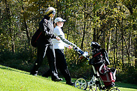 Edgewood's Grace Jaeger walks with assistant coach Betsy Zadra on No. 10 during the Wisconsin WIAA state girls high school golf tournament on Monday, 10/14/19 at University Ridge Golf Course