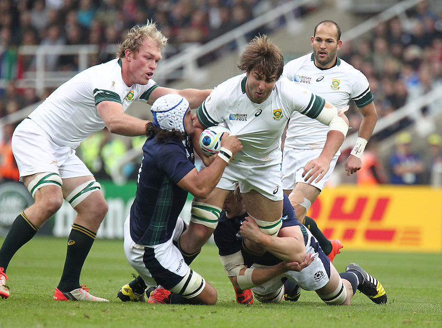 South Africa's Lood de Jager is tackled by Scotland's Blair Cowan<br /> <br /> Photographer Rich Linley/CameraSport<br /> <br /> Rugby Union - 2015 Rugby World Cup Pool B - South Africa v Scotland - Saturday 3rd October 2015 - St James's Park - Newcastle<br /> <br /> &copy; CameraSport - 43 Linden Ave. Countesthorpe. Leicester. England. LE8 5PG - Tel: +44 (0) 116 277 4147 - admin@camerasport.com - www.camerasport.com
