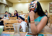 "Maximo a Lucha Libre wrestler, an ""Exotico"" meaning he fights as a gay Luchador having a quick snack with his wife India Siux and children at a restaurant before he enters the ring. Mexico City"
