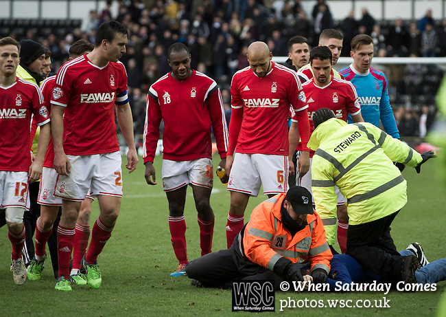 Derby County 1 Nottingham Forest 2, 17/01/2015. iPro Stadium, Championship. Visiting players watching a steward apprehending a supporter at the conclusion of Derby Country's Championship match against Nottingham Forest at the iPro Stadium, Derby. The match was won by the visitors by 2 goals to 1, watched by a derby-day crowd of 32,705. The stadium, opened in 1997, was formerly known as Pride Park. Photo by Colin McPherson.