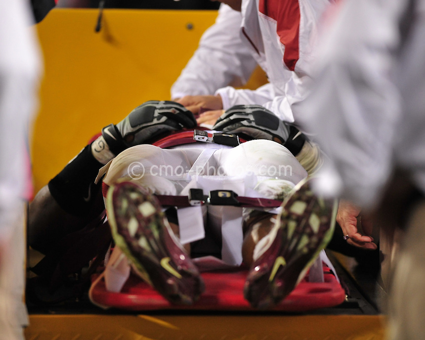 Jan 1, 2011; Glendale, AZ, USA; Oklahoma Sooners linebacker Ronnell Lewis (56) is taken off the field on a cart after a helmet-to-helmet hit in the 3rd quarter of the 2011 Fiesta Bowl against the Connecticut Huskies at University of Phoenix Stadium.  The Sooners won the game 48-20.
