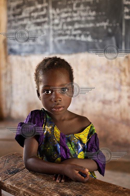 A portrait of a girl in a classroom at Megetana Sirakoro school on the outskirts of Bamako.