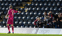 Goalkeeper Ryan Allsop of Wycombe Wanderers throws his gloves to young supporters following his WW Debut during the Sky Bet League 2 match between Wycombe Wanderers and Luton Town at Adams Park, High Wycombe, England on 6 February 2016. Photo by Andy Rowland.