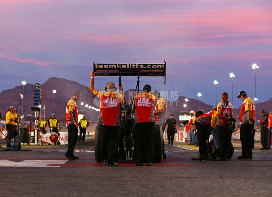Oct 31, 2014; Las Vegas, NV, USA; Crew members stand with NHRA top fuel driver Doug Kalitta during qualifying for the Toyota Nationals at The Strip at Las Vegas Motor Speedway. Mandatory Credit: Mark J. Rebilas-USA TODAY Sports