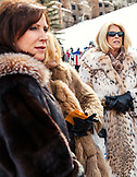 USA, Colorado, Aspen, a group of women in fur coats at the base of the gondola, Aspen Ski Resort, Ajax