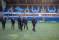 Referee Lee Collins and officials check over the frosty pitch during the Sky Bet League 2 match between Wycombe Wanderers and Newport County at Adams Park, High Wycombe, England on 2 January 2017. Photo by Andy Rowland.