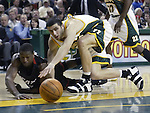Miami Heat's Dwayne Wade. left, and Seattle Supersonics' Vladimir Radmanovic of Serbia & Montenegro, (77) go for a loose ball in the first quarter at Key Arena in Seattle, Washington  on Friday, 13 March 2005.  Jim Bryant Photo. ©2010. All Rights Reserved.